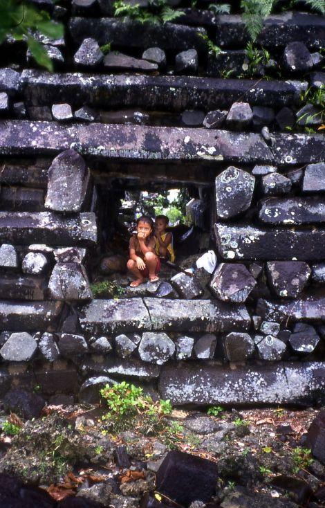 Kids_in_Passage_Through_Basalt_Wall,_Nan_Madol,_Pohnpei